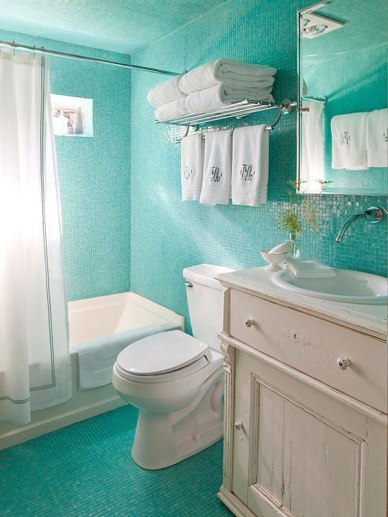 This bathroom creatively uses an old cabinet and bright tile, but the fixtures are all white!. Great design from Fresh Home!!!