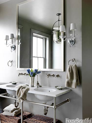 One Mirror...two sinks.www.housebeautiful.com