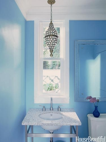 Small bath with bold wall color...note everything else is white.