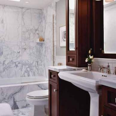 This Old House shows how to make the most of a small bathroom with tall storage cabinets.