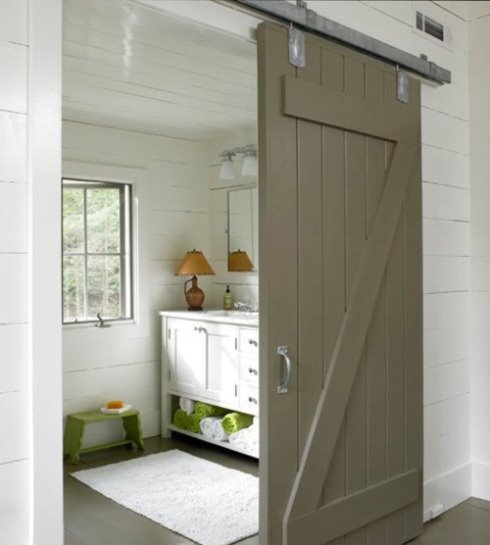 Barn doors are great on bathrooms. www.contentinacottage.blogspot.com